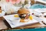 foodiesfeed.com_juicy-burger-in-a-vibrant-interior.jpg